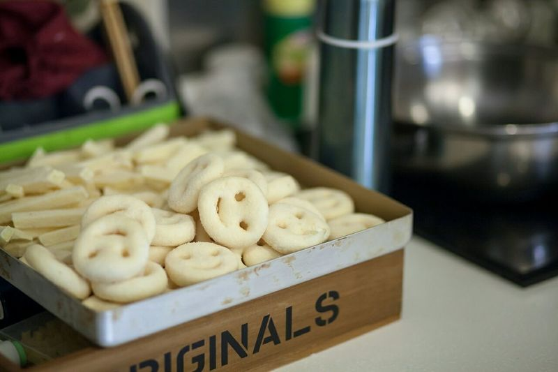 High Angle View Of Smiley Face Food In Container On Table