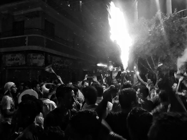 Egyptians celebrate the qualifications to the world cup in the street of uperegypt Photooftheday Indoors  Real People Mobilephotography Streetphotography People Uper Egypt Young Adult Adult Only Men Day Lifestyles