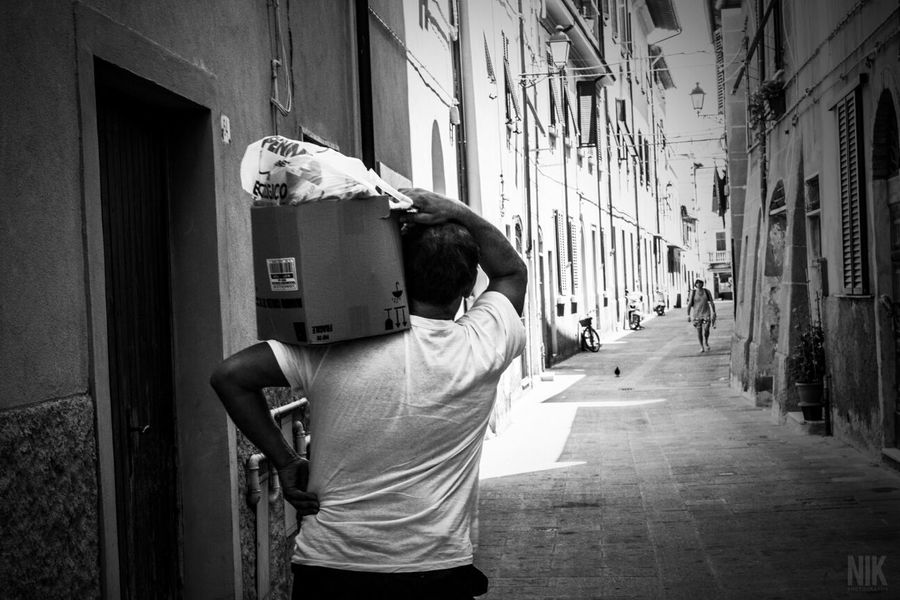 """Work day"" - Piombino Italy Streetphotography Streetphoto_bw Italy Tuscany"