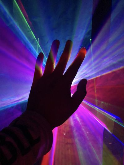Close-up of person hand holding illuminated light