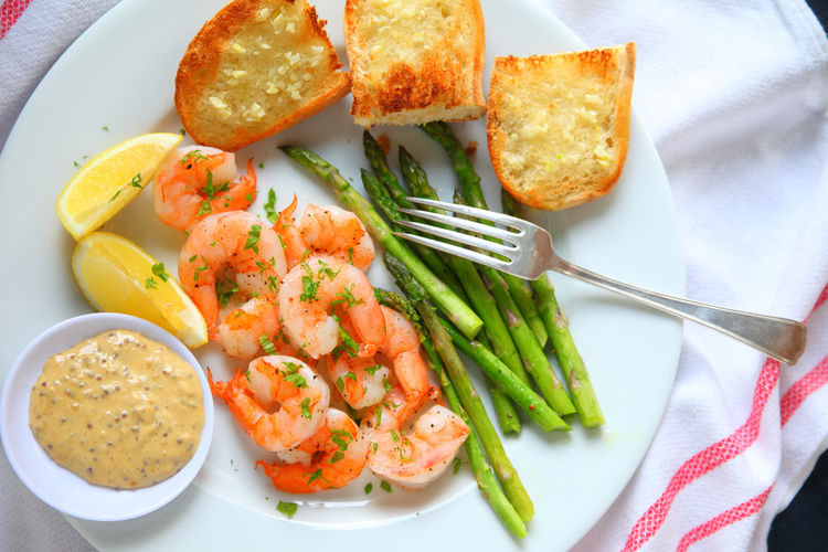 Shrimp with asparagus and tangy sauce Asparagus Balanced Meal Close-up Colorful Day Dinner Dipping Sauce Directly Above Dish Cloth Fabric Fork Freshness Garlic Bread Healthy Eating Home Cooking Homemade Food Indoors  Lemon Natural Light No People Ready-to-eat Shrimp Supper White Plate