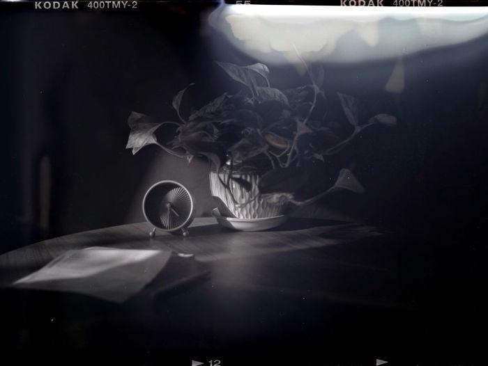 Close-up of smoke emitting from glass at night