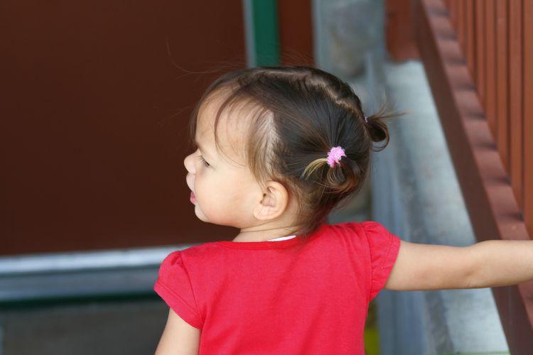 Girl looking at camera at home