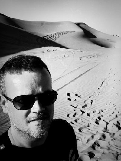 High Angle Portrait Of Mid Adult Man Standing At Desert During Sunny Day