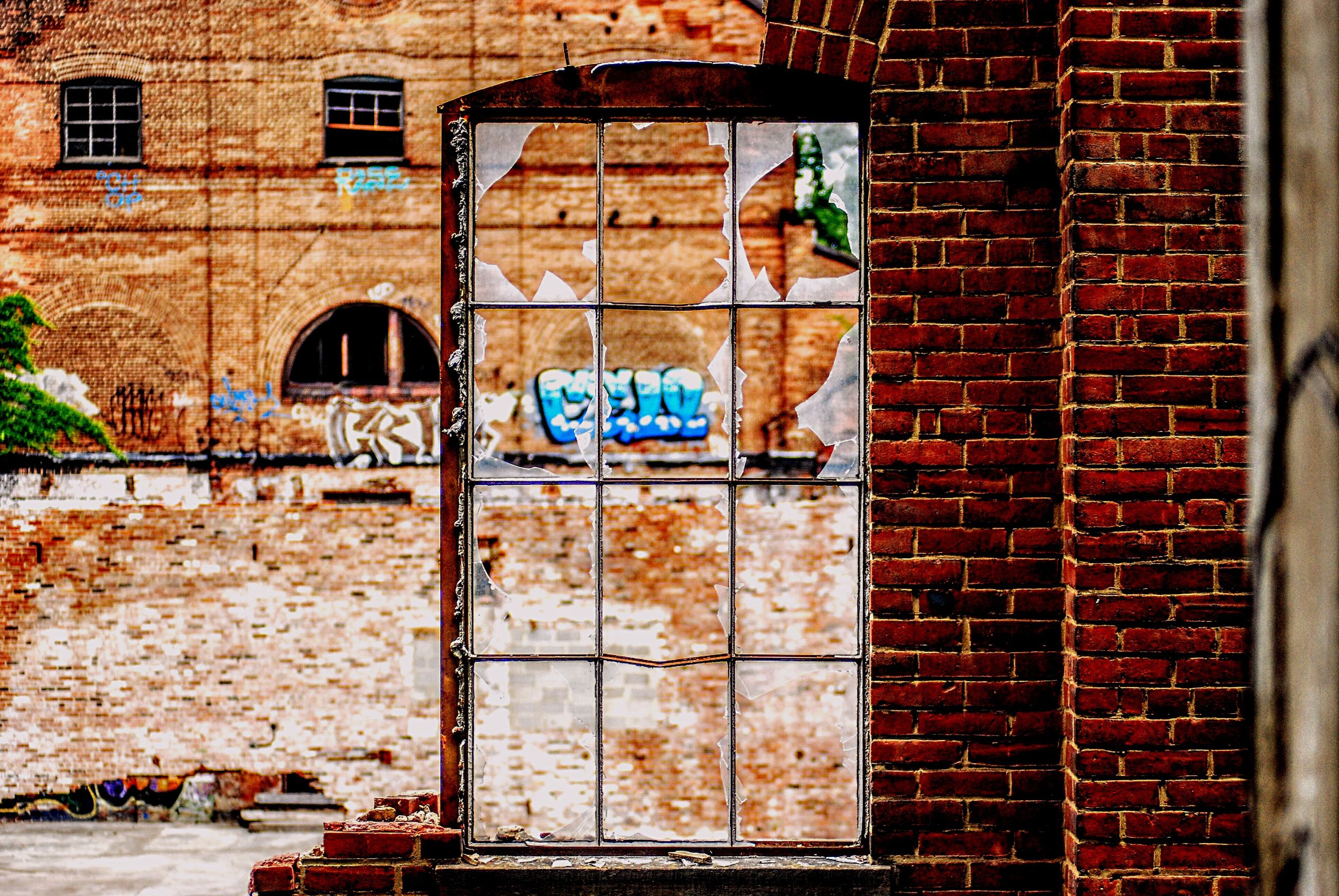 architecture, building exterior, built structure, brick wall, window, communication, text, outdoors, day, no people