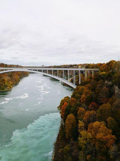 Bridge over river against sky