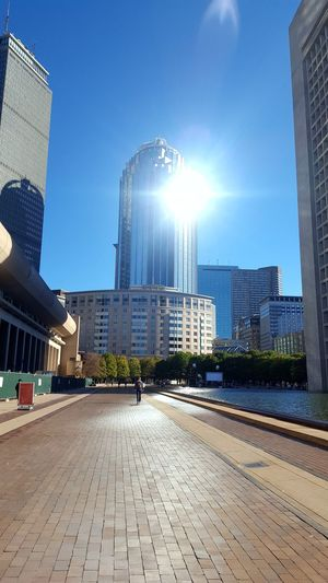 beautiful sun reflection CopleySquare Walking By Early Morning Mobile Conversations