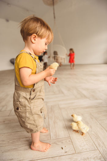 Full length of cute boy playing on floor