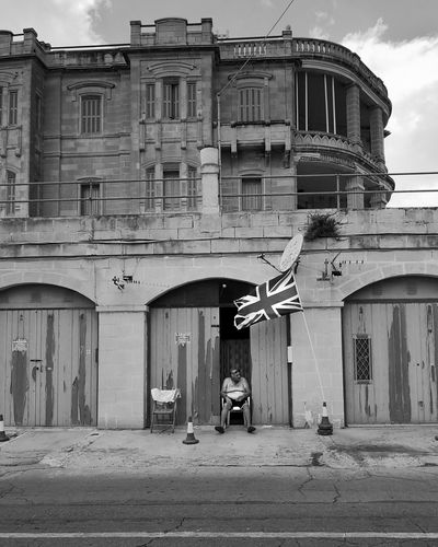"""""""se détendre"""" Series of a street photography project that focusing on the Maltese people. Blackandwhite Vacations Trip Streetphotography Malta Maltaphotography People Street Black & White Blackandwhite Photography Project Old People Friends Old Friends Vacation Flag Ghetto Façade Business Finance And Industry Architecture Building Exterior Built Structure Sky Abandoned Civilization"""