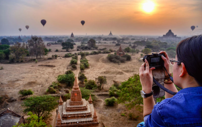 Bagan The Land of Pagodas in The Republic of the Union of Myanmar Photography Themes Travel Destinations Built Structure One Person Tourism Photographing Technology Holding Activity Tourist Belief Architecture Communication Travel Wireless Technology Religion The Past Nature Sky