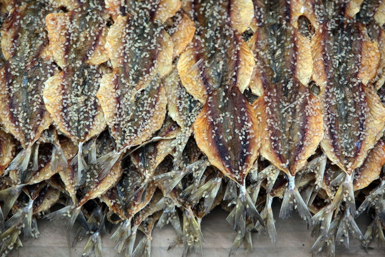 Close-Up Of Dried Fishes At Market Stall