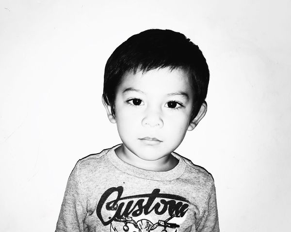 seventeen. B & W By Yeli Black And White One Person Looking At Camera Childhood Portrait Real People T-shirt Black Hair Front View Headshot White Background Boys Studio Shot Close-up People