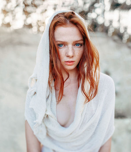 Beautiful redhead girl in white hood clothes. Dessert clothes Portrait Looking At Camera One Person Beauty Beautiful Woman Young Adult Hair Young Women Long Hair Front View Hairstyle Adult Focus On Foreground Women Standing Waist Up Redhead Lifestyles Outdoors Freckles Girl Sexygirl Serious Seriousface Art Photography Art Portrait  Fine Art Photography Hood Hood - Clothing Dessert Desert Clothes Seductive Women Sensual_woman