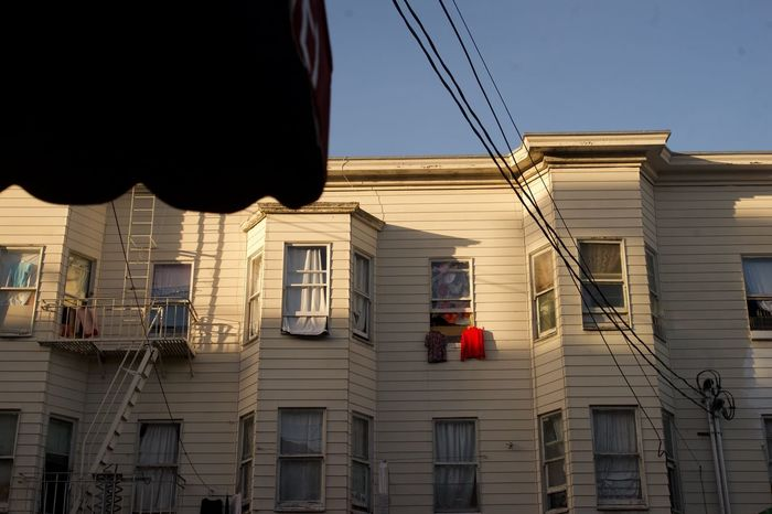 Red shirt Chinatown Red Color Laundry Building Exterior Architecture Built Structure Window Low Angle View Building Cable Residential Building Drying Outdoors Hanging