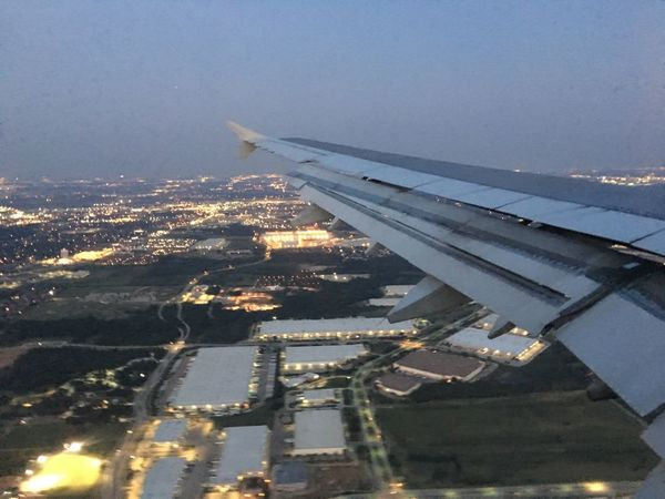 Approach for landing at DFW International Airport Airplane Aerial View Transportation Airplane Wing No People Journey Outdoors Nature Air Vehicle Sky Water City Beauty In Nature dusk The Week On EyeEm