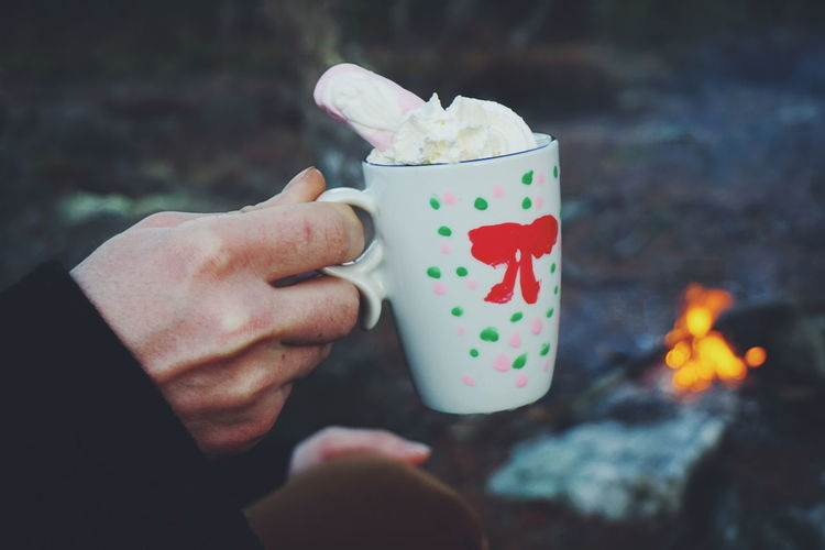 drinking coffe with wipped cream and in front the campfire Human Hand One Person Holding People Human Body Part Outdoors Winter Christmas Around The World Christmas Heat - Temperature Lifestyles Young Adult Warm Clothing Coffee Break Campfire Handmade Burning Forest Photography WoodLand Nature Leisure Activity Finding New Frontiers Wintertime Christmastime DIY The Great Outdoors - 2017 EyeEm Awards