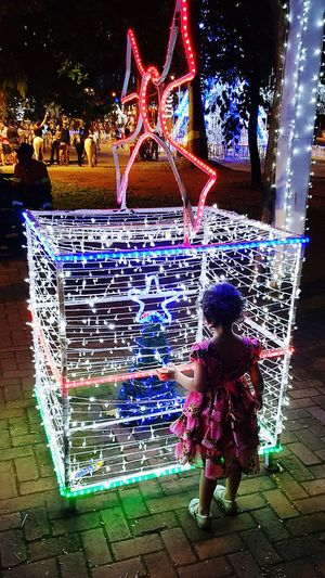 Christmas gift 🎁 Christmas Lights Gift Endofyear Ligth Colors Night One Person Full Length Childhood Girls Real People Night Child first eyeem photo