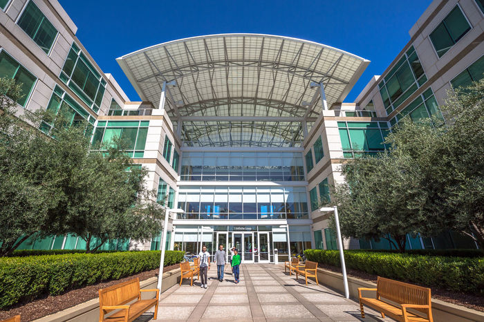 Cupertino, California, United States - August 15, 2016: the Apple world headquarters at One Infinite Loop. Apple is a multinational that produces consumer electronics, personal computers and software. people come from the popular Apple store of Apple Inc Headquarters at One Infinite Loop located in Cupertino, Silicon Valley, California. Apple California IT Mac PC United States Architecture Building Building Exterior Built Structure City Clear Sky Computer Cupertino Day Electronics Industry Flag Futuristic Headquarter Headquarters Hq IMac27 IPhone Imac Infinite Loop Mobile Modern Outdoors Real People Sky Store Tree