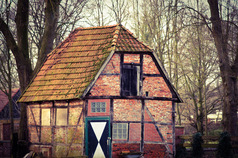 The old house... Real Estate Farmer's House Farm Village Life Village Photography Rural Barn Cottage Old House Travel Destinations Germany Historical Building In Front Centered Perspective Autumn colors Landscape Travel Copy Space Tree Bare Tree Sky Architecture Building Exterior Built Structure Roof Rooftop Roof Tile Traditional Building Housing Settlement Tiled Roof