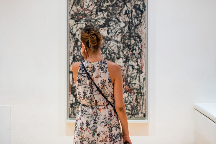 Guggenheim Museum Peggy Guggenheim Collection One Person Standing Wall - Building Feature Indoors  Women Young Adult Hairstyle Waist Up Floral Pattern Fashion Real People Casual Clothing Adult Dress Three Quarter Length Lifestyles Hair Young Women Contemplation Beautiful Woman Pollock