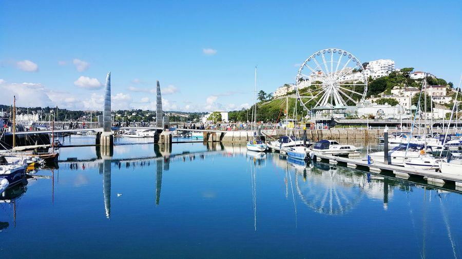 View of ferris wheel at harbor