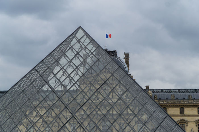 Street and river scenes along the Seine Architecture City Cloud - Sky Day Flag Government Modern No People Outdoors Politics Pyramide Du Louvre Sky