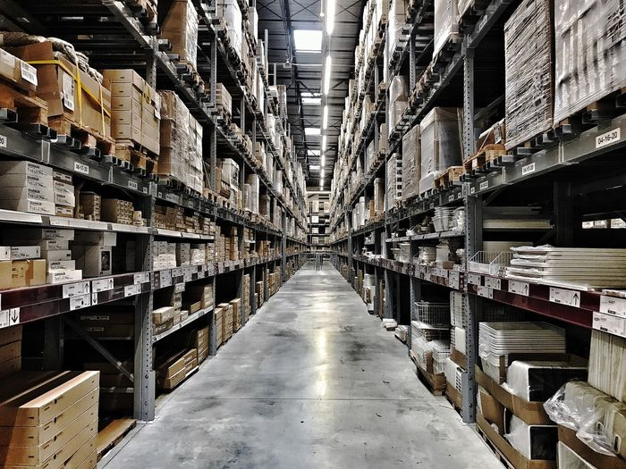 A warehouse scene that can be used as a backdrop. Warehouse Storage Compartment Storage Room Freight Transportation Distribution Warehouse In A Row Indoors  Large Group Of Objects Stack Retail  Industry Order Rack Store Shipping  Organization Arrangement Checklist Cardboard Box