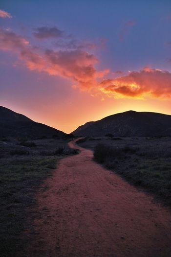 Sky Sunset Environment Scenics - Nature Landscape Nature Beauty In Nature Tranquility Cloud - Sky Tranquil Scene No People Land Dirt Road Mountain Dirt The Way Forward Non-urban Scene Direction Dusk Road