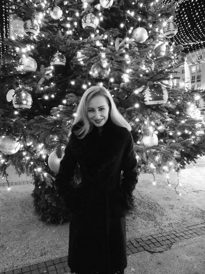 Blackandwhite Blond Hair Christmas Lights Christmas Tree Christmas In The City Beautiful Woman One Woman Only Looking At Camera Young Women Cheerful Christmas Decoration