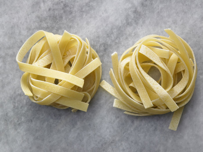 tagliatelle pasta Cooking Dried Food Food And Drink Noodles Shape Tagliatelle Textured  Wheat Carbohydrate - Food Type Close-up Directly Above Food Freshness Healthy Eating High Angle View Indoors  Ingredient Italian Food No People Nutrition Pasta Product Raw Food Still Life Table