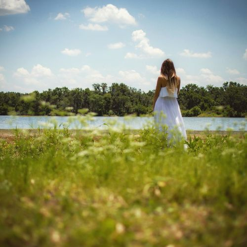 Girl Plant Water Sky Women One Person Beauty In Nature Grass Real People Nature Tranquility Lake Day Tranquil Scene Green Color Rear View Adult Standing