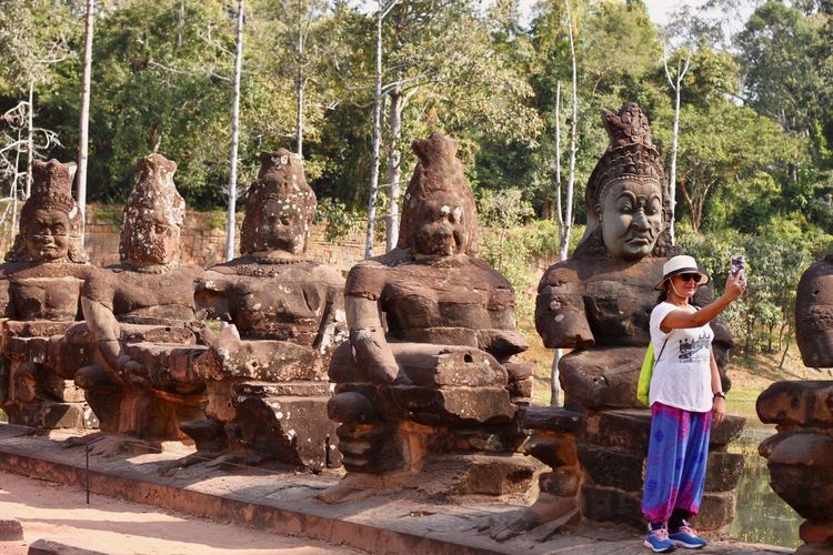 Angkor Angkor Wat, Cambodia Cambodia Angkor Thom Architecture Art And Craft History Sculpture Khmer Architecture Khmer Culture Travel Destinations Travel Tourism Women One Person Ancient Tourist Taking Photo Selfie