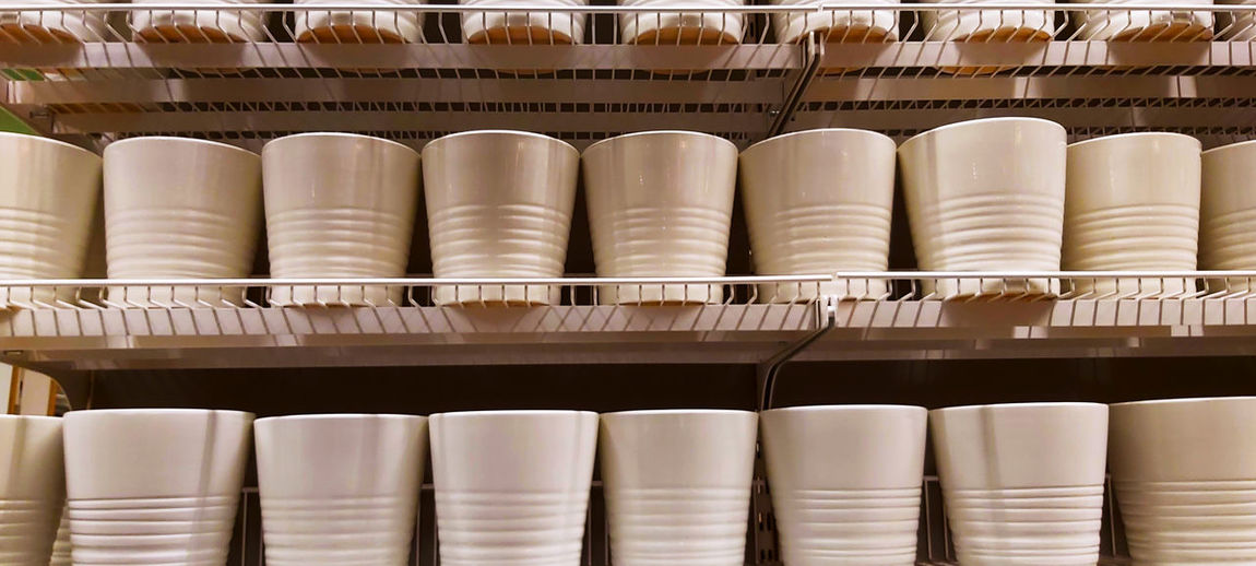Close-up of ceramic glasses on shelf