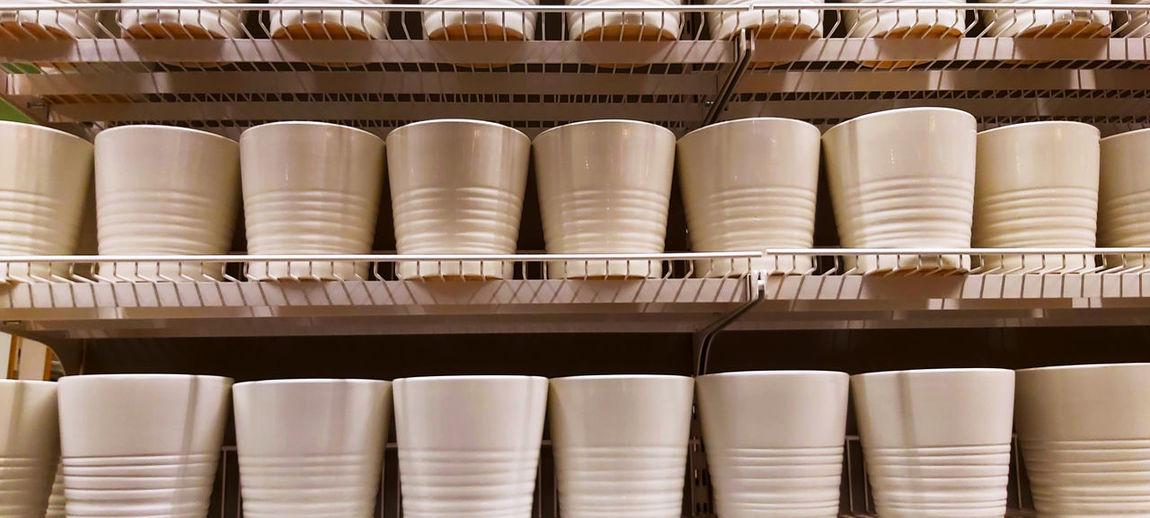 Close-up of ceramic glasses on shelf