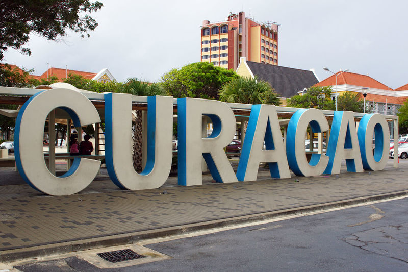 Curacao logo in downtown of Willemstad Architecture Building Exterior Caribbean City Curacao Downtown Dutch Antilles Landmark Leeward Islands Logo Netherland Antilles Outdoors Panorama Tourism Tourist Attraction  Town Travel Travel Destinations West Indies Willemstad