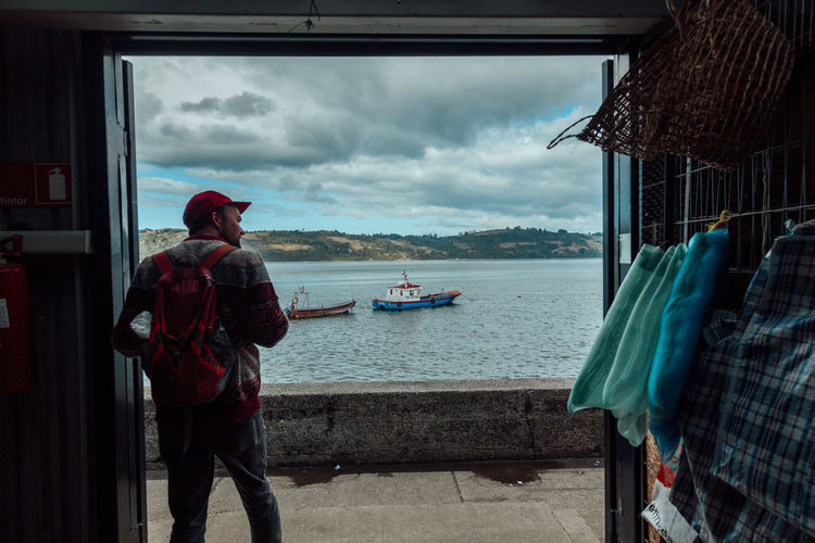 Chiloé, Chile Chiloé, Chile Nature Wanderlust Architecture Boats Building Exterior Built Structure Cloud - Sky Day Man Standing Men Nature Nautical Vessel One Person Outdoors People Real People Sea Sea View Sky Transportation Travel Destinations Water