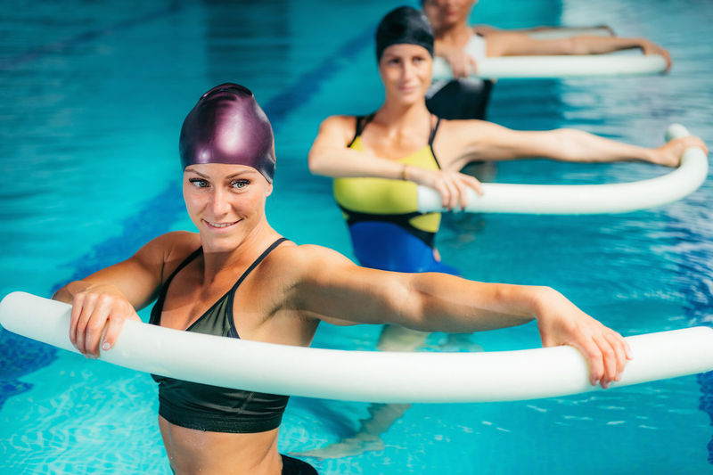 High angle view of swimmers exercising in swimming pool