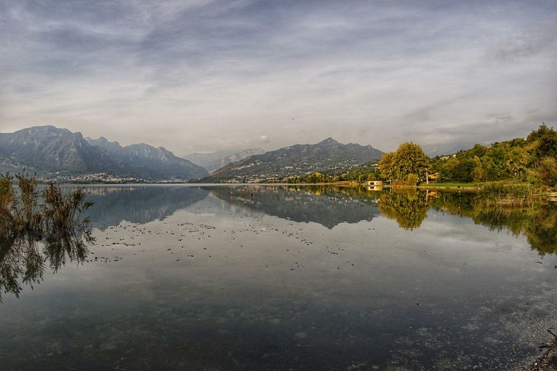 lago di Annone Annone Di Brianza Annone Oggiono Lake Panorama Autunno🍁 Autunno  Coloriautunnali Lago EyeEm Selects Water Lake Symmetry Reflection Sky Scenics Reflecting Pool Countryside Non-urban Scene Mountain Range Tranquil Scene Rocky Mountains Idyllic Tranquility Mountain