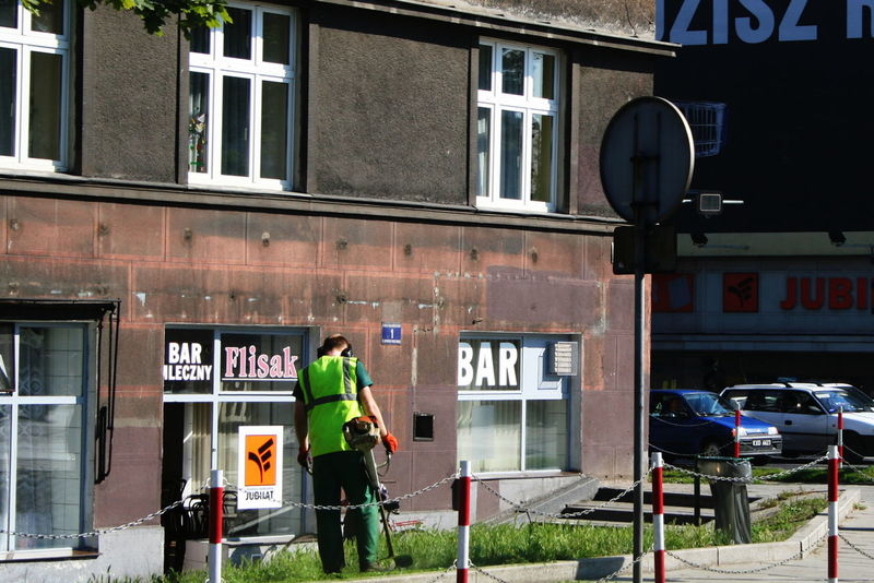 2007 Poland Architecture Building Exterior Built Structure City Cutting Grass Day Krakow One Person Outdoors Real People Road Sign Street Works Text