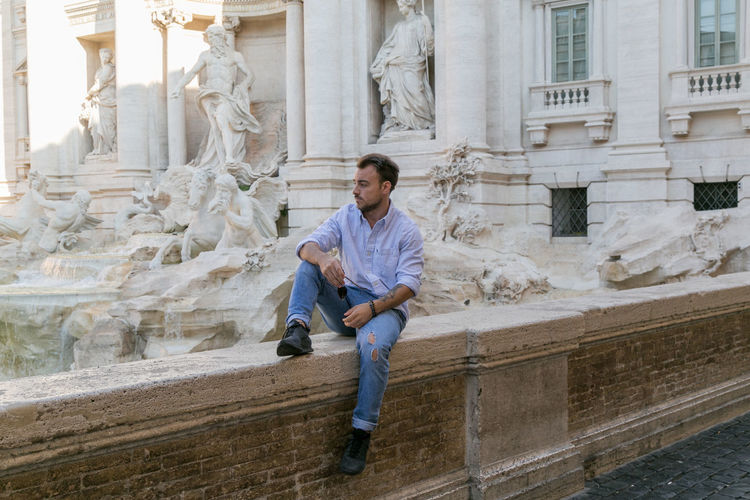 Architecture Full Length One Person Built Structure Building Exterior Front View Sitting Casual Clothing The Past Real People History Staircase Day Men Young Adult Sculpture Lifestyles Architectural Column Solid Outdoors Italy Italia Man Menswear Street Streetphotography Streetsyle Fashion Rome Roma The Street Photographer - 2019 EyeEm Awards