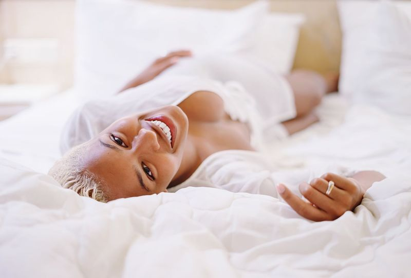 """"""" H E R """" Bed Relaxation Real People Indoors  Young Adult Young Women Lying Down Looking At Camera One Person Home Interior Bedroom Portrait Comfortable Lifestyles Leisure Activity Sheet Beautiful Woman Smiling Women Day"""