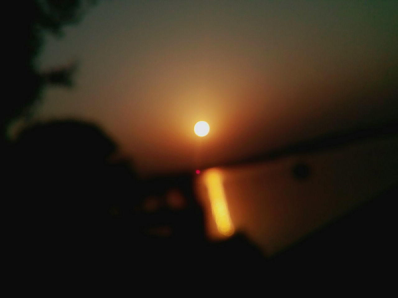 nature, sunset, sun, beauty in nature, sky, silhouette, outdoors, scenics, real people, moon, solar eclipse, close-up, astronomy, crescent