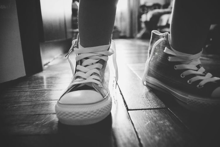 Shoe Human Leg Lifestyles Indoors  Pair Standing Close-up Real People Snickers Footwear Children Photography Black And White Kids Legs Trying On White Lace Kids Being Kids Toddler Girl Low Angle