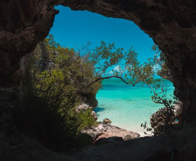 🌴Pirates Cove🌴~ Rock - Object Water Outdoors Landscape Nature Freedom Grandturk Beauty In Nature Tourism Turksandcaicos Godscreation Travel Destinations Summer Vacations Tropical Climate Sea Nature Beach Exploration Cave Perspectives On Nature