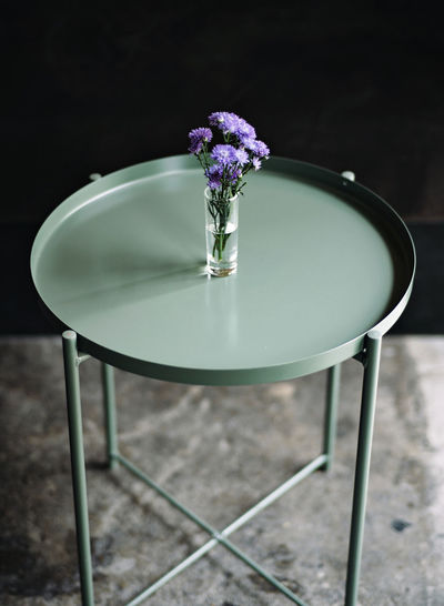 Purple flower vase on table