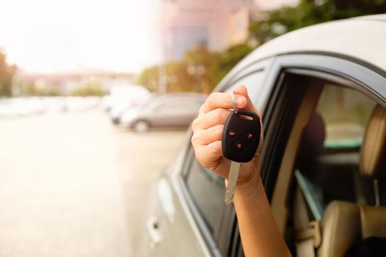 Cropped hand holding car key