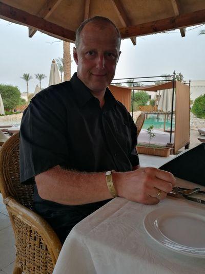 Portrait of man sitting at restaurant table