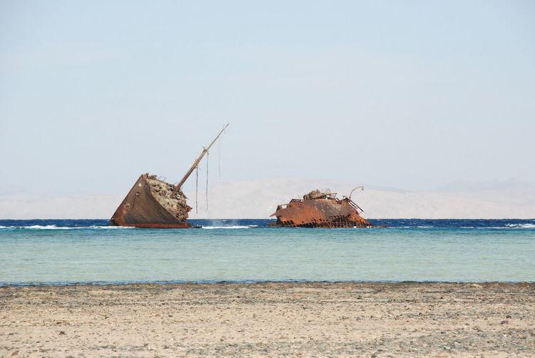 Damaged Ship On Beach Against Sky