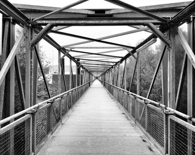 Empty footbridge along footpath