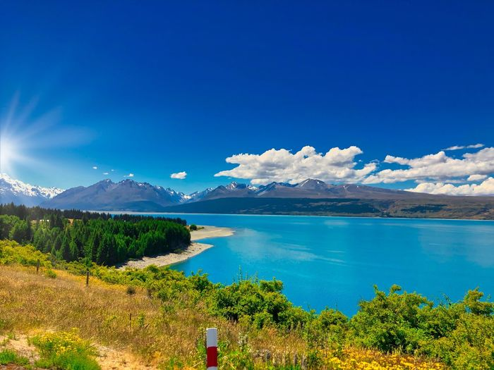 Glentanner, New Zealand Sky Mountain Water Scenics - Nature Blue Beauty In Nature Tranquil Scene Plant Tranquility Cloud - Sky Lake Nature Mountain Range Day No People Tree Landscape Non-urban Scene Environment Outdoors Turquoise Colored A New Beginning